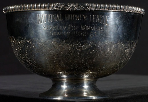 "A colour photograph of a copper silver-plated bowl engraved with ""National Hockey League, Stanley Cup Winners, Season 1952–53."""
