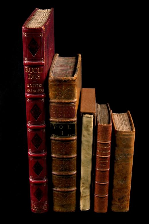 Colour photograph of a row of books: left to right: Euclid's Elementa, 1482; Milton's Paradise Lost, 1758; Relation de ce qui s'est passé en la mission des pères de la Compagnie de Iésus …, 1651; Sophocleos Tragoediai, 1502; The Lower-Canada Watchman, 1829.