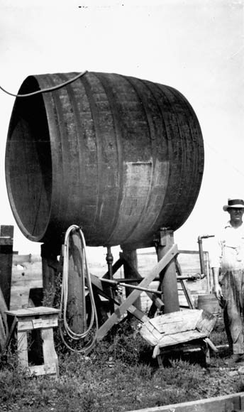 A black-and-white photograph of a Pelee Island wine vat now used as a water reservoir.
