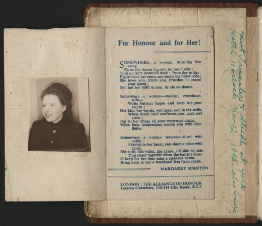 "A colour photograph of a book opened at the first page. A pamphlet has been glued on the inside cover which has a photograph on one side and an ode to the women who stayed home entitled ""For Honour and for Her!"""