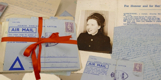 A colour photograph of piles of letters, with one bundle held together by a red ribbon. Underneath them is a photograph of a young woman wearing a coat and stylish hat.