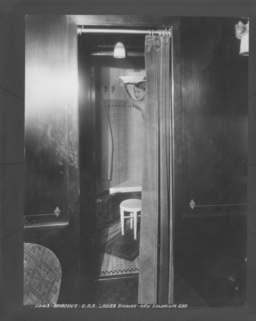 A black-and-white photograph of a ladies' shower room in a Canadian Pacific Railway solarium car.