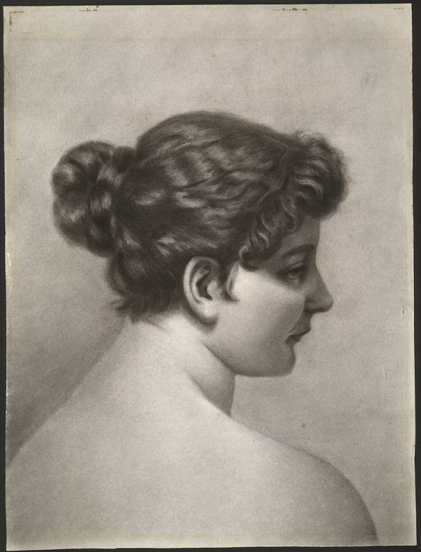 A charcoal drawing on paper of a young woman with bare shoulders seen from the back with her face in profile. Her hair is styled in a loose bun with short curls framing her face. Her gaze is off to the right.