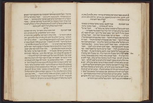 A colour photograph of an open book with Hebrew writing.
