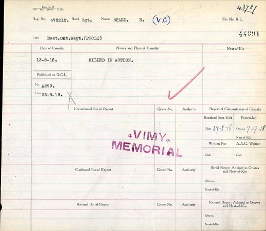 "A beige document with lines separating boxes, a red check mark, and a large purple stamp reading ""Vimy Memorial."""