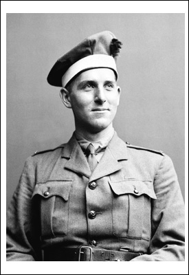 A black-and-white portrait photograph of a soldier.