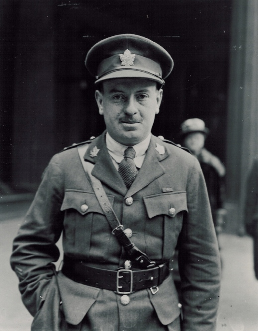 A black-and-white photograph of a soldier standing with his right hand in his trouser pocket.
