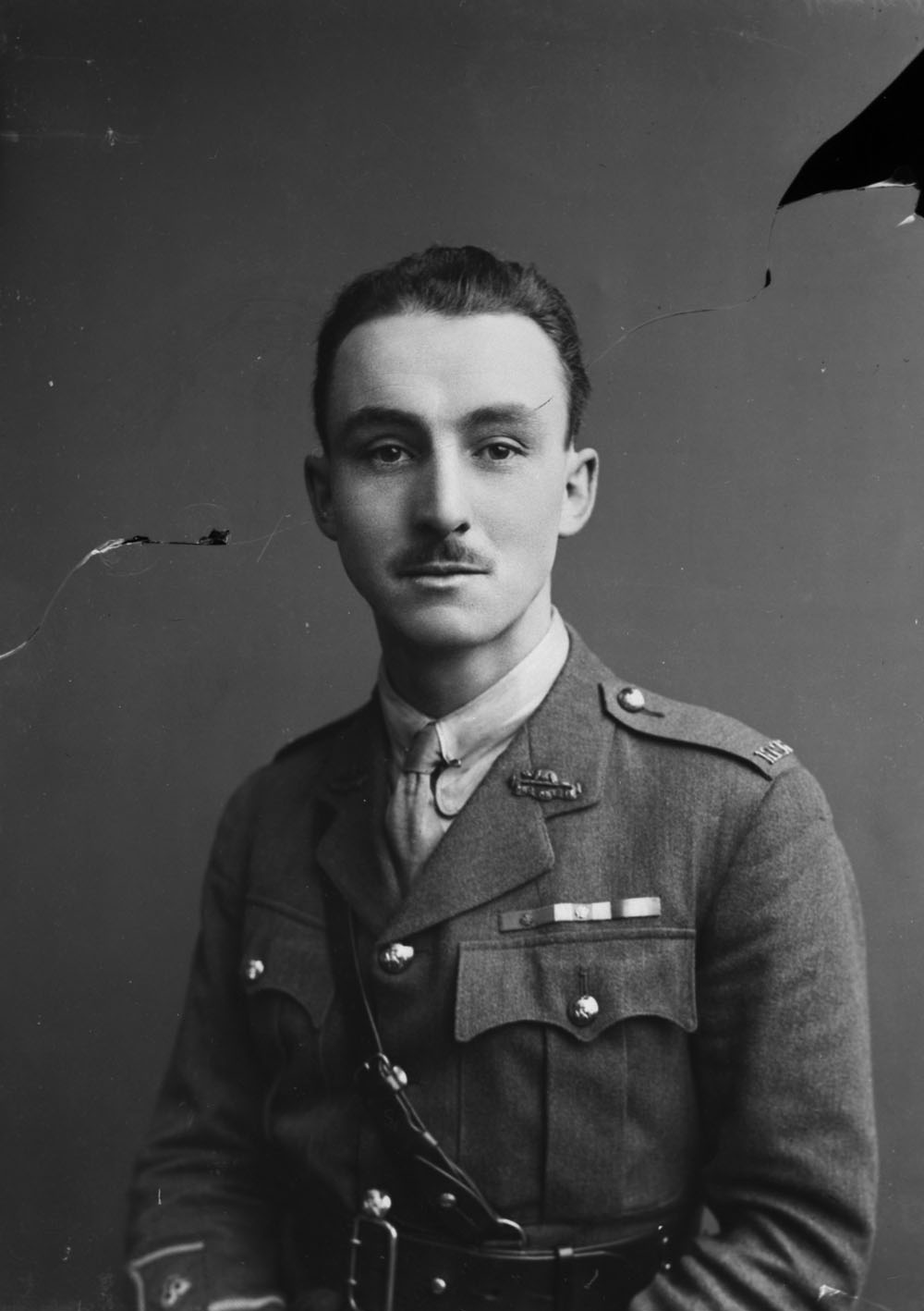 A black-and-white photograph of a soldier.