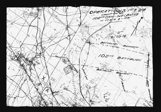 A black-and-white map showing boundaries and outlines of buildings and structures.