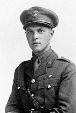 A black-and-white photograph of a soldier wearing a cap and a Sam Brown belt, part of an officer's uniform.