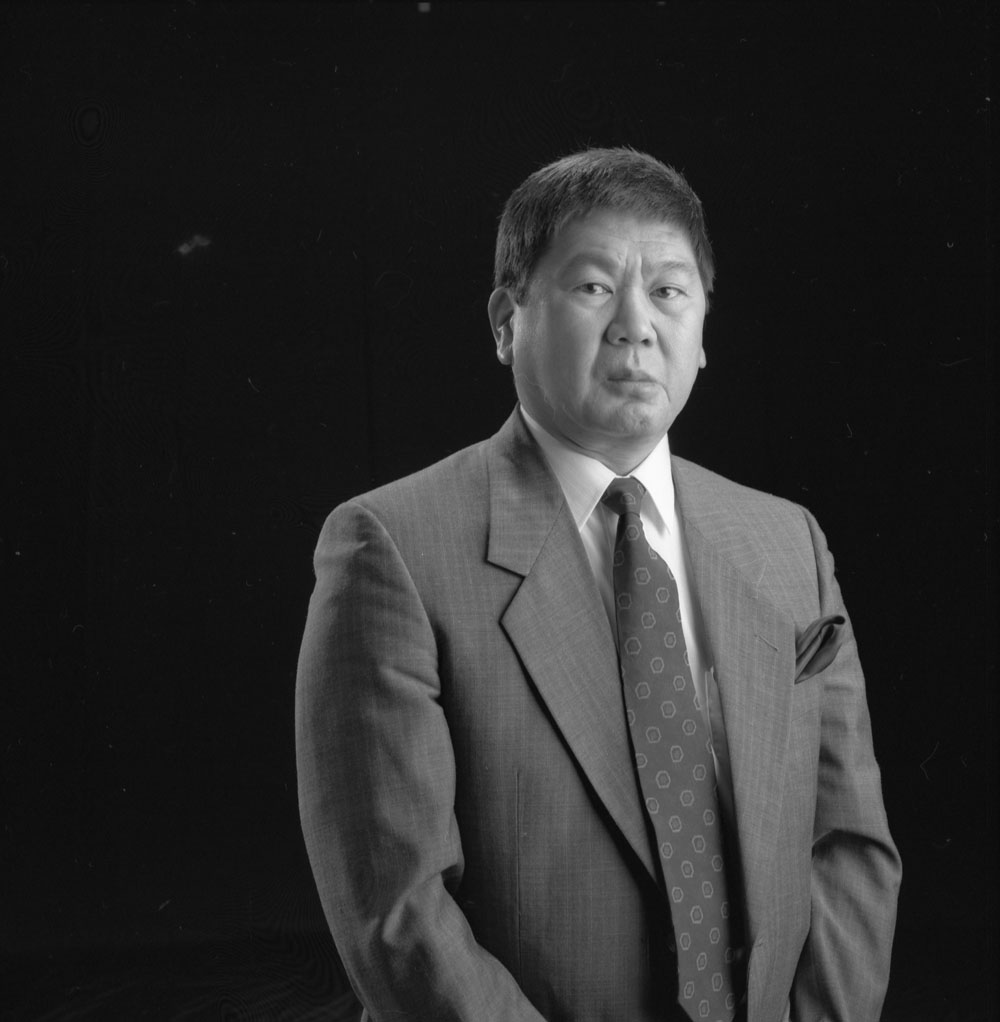 A black-and-white, head-and-shoulder photograph of Art Miki.