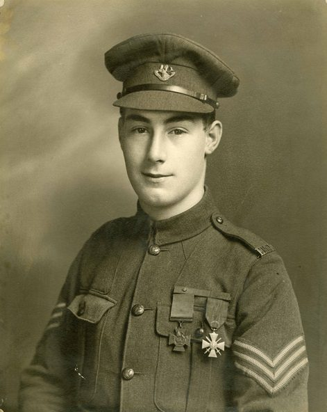 A sepia photograph of a soldier in uniform with a Victoria Cross and a Croix de Guerre pinned to his chest.