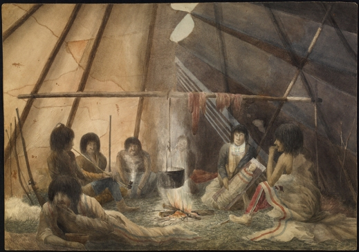 A watercolour showing the interior of a tent. Seven people are sitting around a fire. One is a mother with a child in a cradleboard. Pelts or meat are drying on a cross beam and a pot of food is over the fire. A musket and a bow and arrows are leaning against the side of the tent. One person is eating and another is smoking a pipe, while the others appear to be observing the artist (Hood) at work.