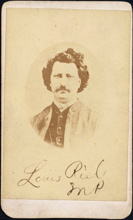 "Sepia-tone vignette photograph of Louis Riel facing the camera, with handwritten inscription underneath reading ""Louis Riel, MP."""