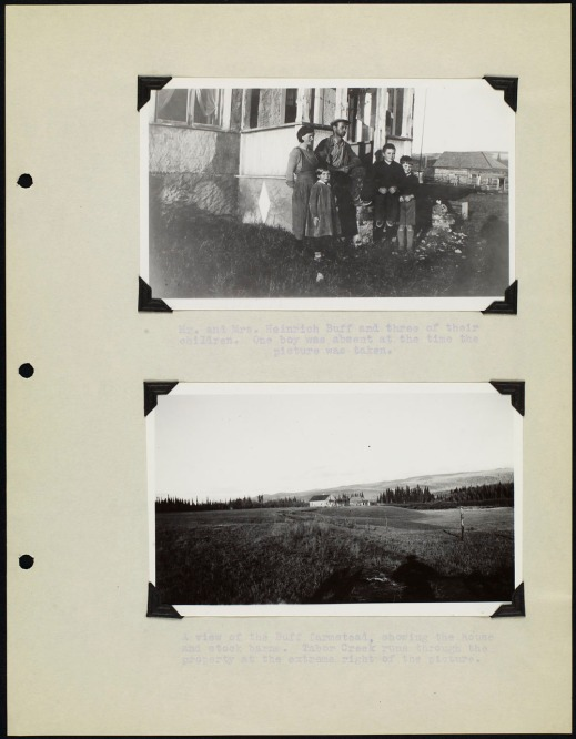 Page from an album with two black and white photographs; one showing a family standing in front of a house and the other showing a view of farmland. The photos are captioned with typed text.