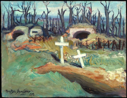 Colour image of a painting depicting two gun emplacements at the edge of a burnt out forest. In the foreground, there are two graves with white crosses. At the bottom-left of the painting is a signature and year: Mary Riter Hamilton 1919.