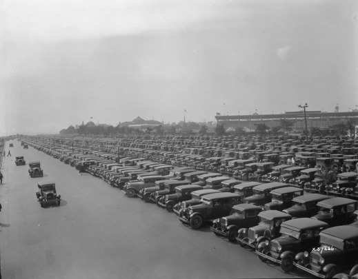 A black-and-white photograph of a large parking lot filled to capacity at the Canadian National Exhibition in Toronto.