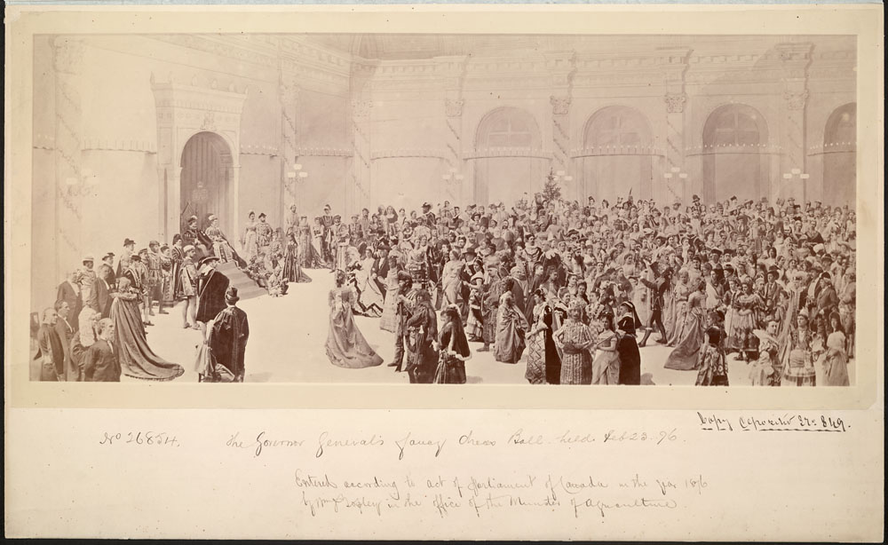 A group photograph of hundreds of costumed guests at a fancy dress ball. The background is a painting of the Rideau Hall ballroom.