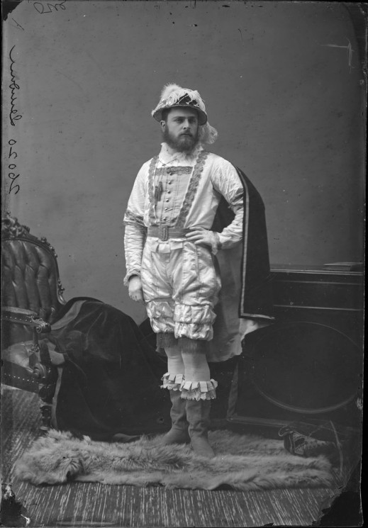 "A black-and-white photograph of a man dressed up as explorer ""Jacques Cartier"" in a photography studio."