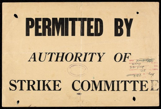"Sign reading ""Permitted by authority of strike committee,"" with a date stamp and a signature authorizing the notice."