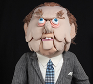 Colour image of a puppet that resembles Prime Minister John Diefenbaker.