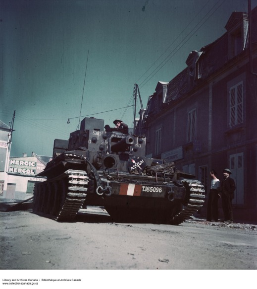 A colour photograph showing an armoured vehicle with a large main gun.