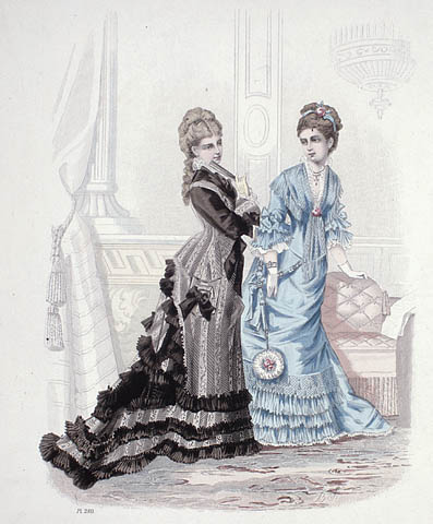 A colour plate of two women standing in a living room. One is wearing a blue dress with ruffles at the sleeves and hem. The other is wearing a striped black and grey dress with a long bustle and ruffles at the hem.