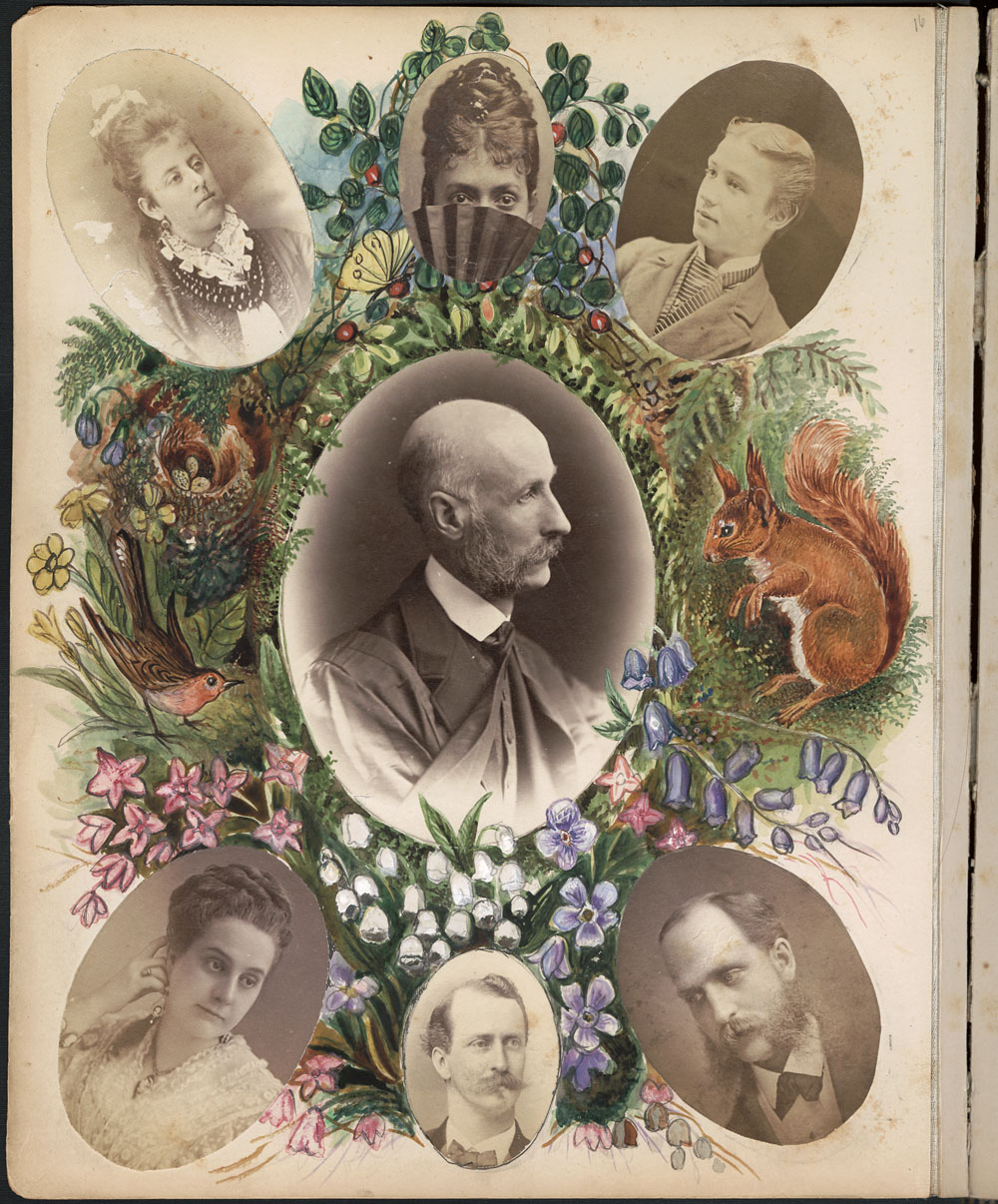 An album page with a large photograph of a man in the centre, surrounded by six smaller photographs of women and men. There are also coloured drawings of flowers, birds and a squirrel.