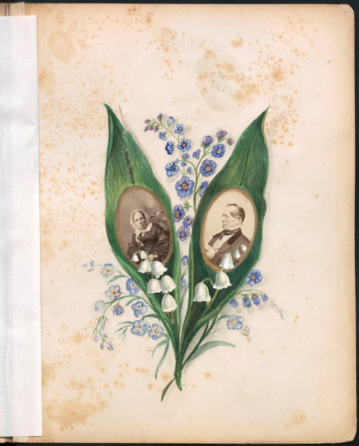 An album page with photographs of a man and a woman in the middle of two green leaves and surrounded by purple flowers.