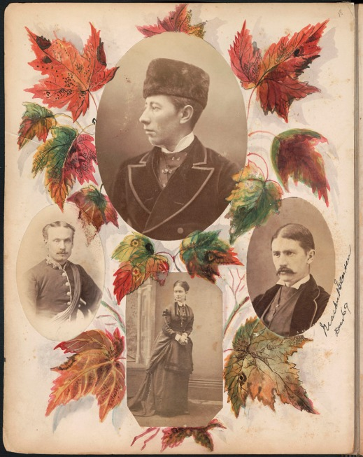 An album page with photographs of three men and a woman, surrounded by coloured maple leaves