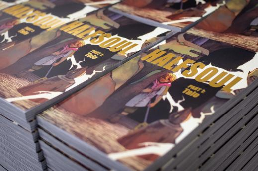 A coloured photograph of stacks of the graphic novel Halfsoul.