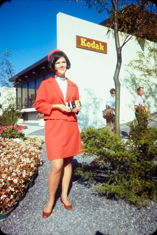 Kodak representative posing outside the Kodak Pavilion at Expo 67.