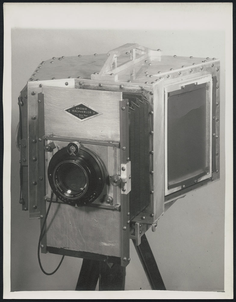 A black-and-white photograph of Macpherson's camera.