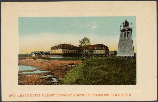A colour postcard depicting a large yellow and brown building and a lighthouse.