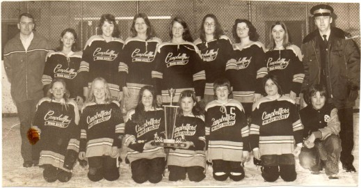 A sepia photo of a girls' hockey team with Campbellford Minor Hockey written on their sweaters.