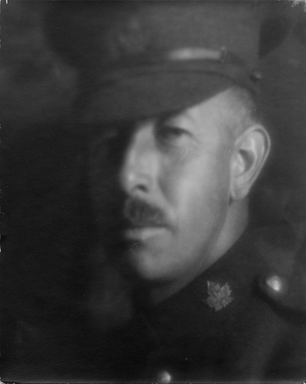 A black-and-white photo of a man in a military uniform.