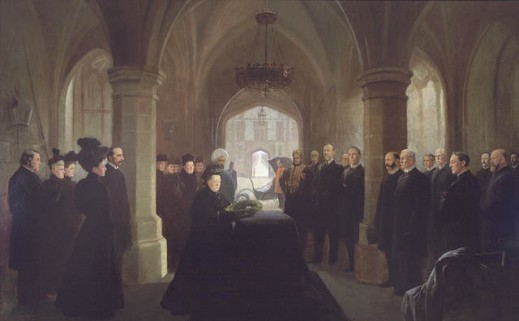 A portrait of those attending the mass held at Windsor Castle for former prime minister Sir John Thompson. Queen Victoria lays a wreath on Thompson's casket while prominent guests and members of her court look on