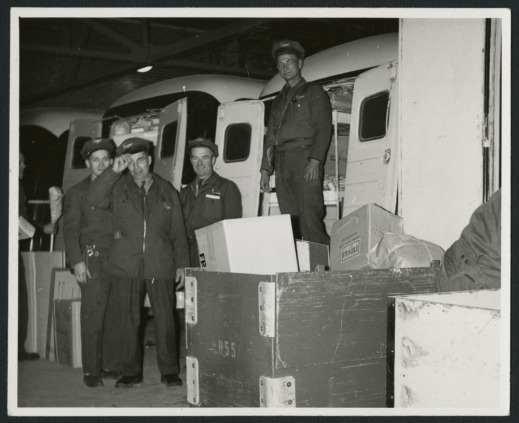 Three black-and-white photographs showing men dressed in uniforms beside Simpson's delivery trucks, over the decades.