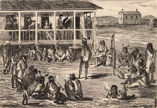 A drawing of people sitting in a circle around a person standing in the middle who is speaking. There is a building with people sitting and standing on the balcony in the background.