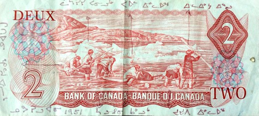 A colour photo of the back of the 1975–1979 Canadian $2 bill, on which the names of the six individuals depicted are written in syllabics.
