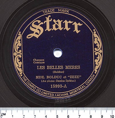 """A colour picture of the label of the song """"Les Belles Mères"""" with golden lettering on a navy disk."""