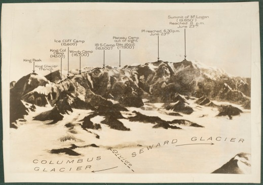 Photograph of Mount Logan with the names of the peaks and routes annotated.